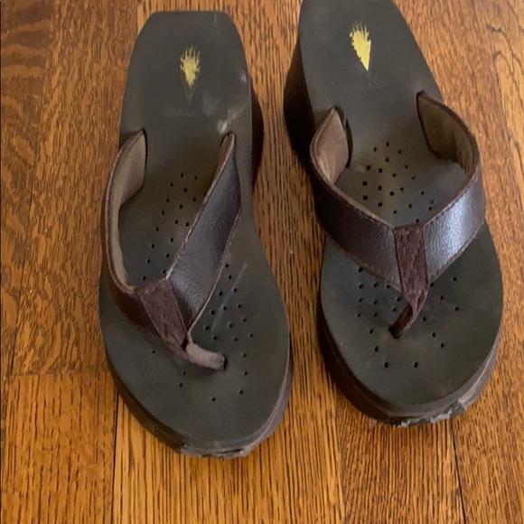 Volatile brown leather flip flops
